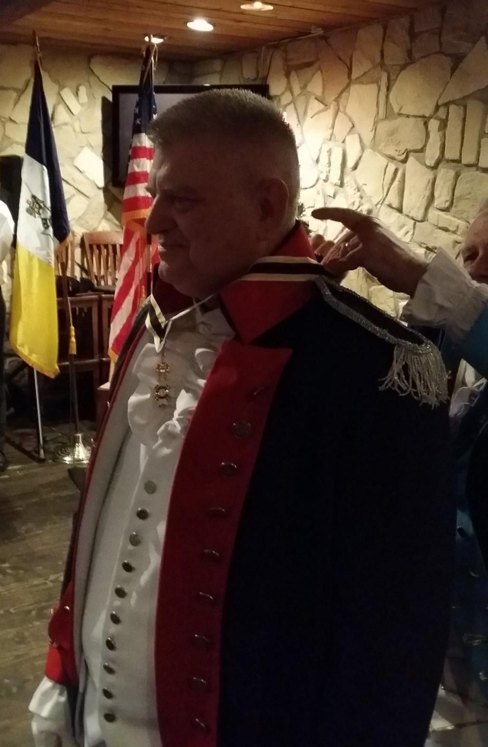 Wayne Courreges Receives Chapter President Neck Ribbon